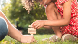 Father and daughter playing together with Yuyu curious blocks and activity cards